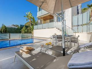 Elegant sea view villa with heated pool and rental license near the golf course in Alcanada