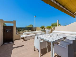 Seafront townhouse with stunning views and communal pool in Llucmajor