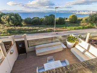 Frontline home with direct sea access, private garden and communal pool in Llucmajor