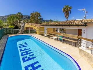 Attractive three bedroom villa with holiday rental license and gated pool in Pollensa