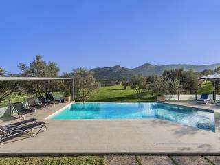 An impressive Mediterranean property with lovely mature gardens and a private pool in Pollensa
