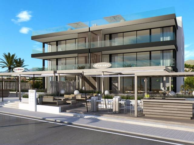 Modern beachfront apartment development with pool in Puerto Pollensa