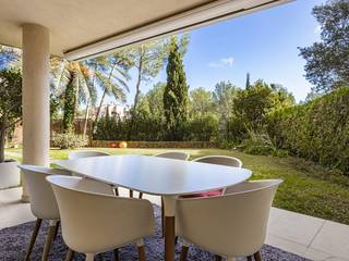 Garden apartment with private garden and access to communal pools in Sol de Mallorca